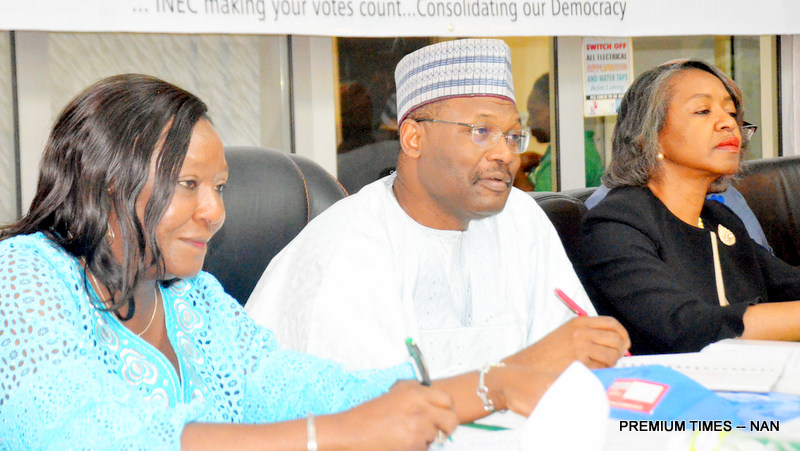 From left: National Commissioner of INEC, Prof. Anthonia Simbine; Chairman of INEC, Prof. Mahmood Yakubu; and another National Commissioner, Mrs May Agbamuche-Mbu, during the INEC quarterly consultative meeting with political parties, in Abuja on Wednesday (4/6/18). 03572/4/6/2018/Hogan Bassey/NAN
