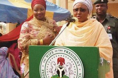 Aisha Buhari as she delivers speech using a lectern with her official seal. [Photo credit: ICIR]