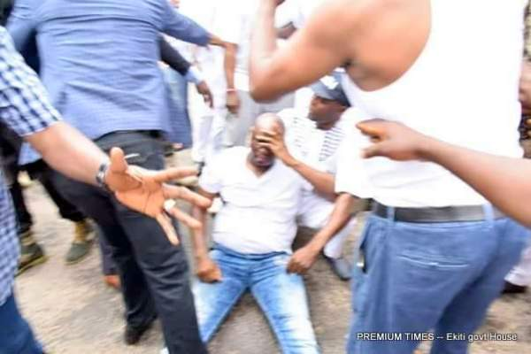 A photograph showing Ekiti State Governor, Chief Ayodele Fayose on the ground after he was attacked with tear gas and beaten by security operatives
