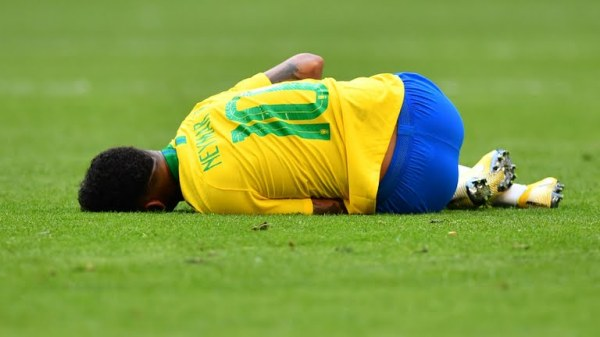 Alavarez gets a yellow card for a dangerous challenge on Neymar who clutches to his kneel. Free kick for Brazil (Photo Credit: Reuters)