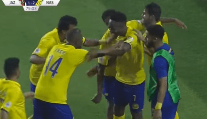 Ahmed Musa celebrates with team mates after scoring