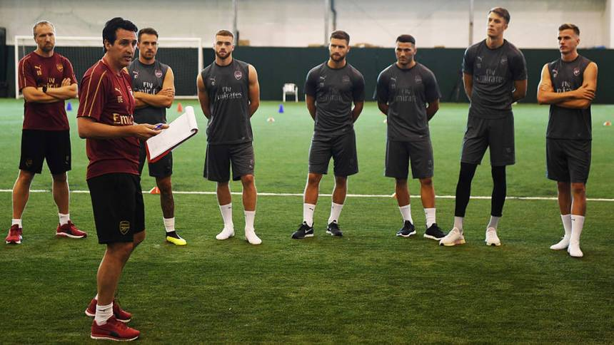 Unai Emery and Arsena, Team members. [Photo credit: Arsenal FC offical website]