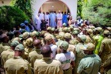 President Muhammadu Buhari with corps members in Daura