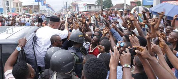Senator Akpabio driving through a large crowd of supporters and admirers in Uyo