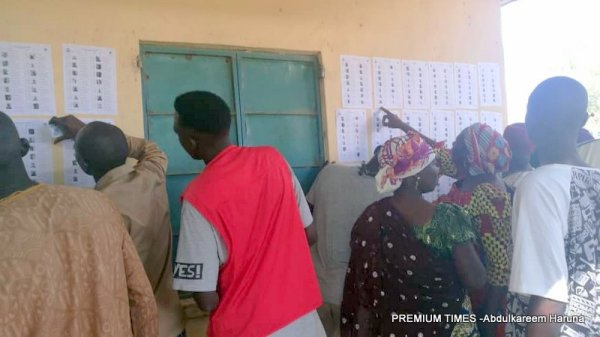 Voters checking their names on register pasted on the wasted at Maryam Kudu central polling unit in Tafawa Balewa LGA