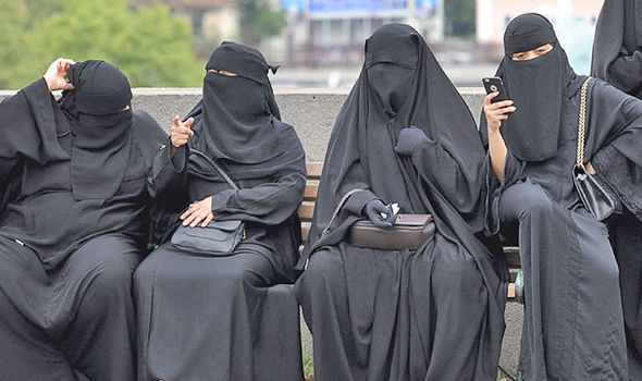 Woman dressed in burqa used to illustrate the story. [Photo credit: Daily Express]