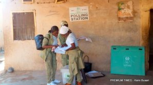 Corps members setting up at Sarkin Tarah, polling unit 003. This is President Muhammadu Buhari's polling unit. But Mr Buhari will not participate in today's election as he is out of the country on vacation.