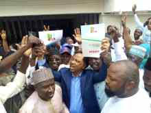 Sen Shehu Sani displaying his nomination form to His Supporters in Abuja