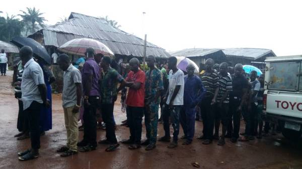 Voters drenched as they cue and Vote under heavy downpour in A polling unit at Ife South LGA.