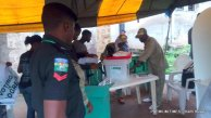 Corps members setting up for the day's work in Asumo Ward 10, unit 2, Ede North. They arrived as early as 7a.m.
