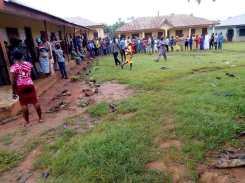823am, PU 005, Ward 02, Ipetu-Ile/Adaowode, Voting Point 1,Baptist Primary School, Obokun LG, voters on a long queue to exercise their franchise.