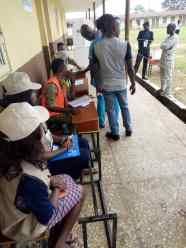 8:54am, PU 002, Ward 01, Ibokun, NUD Primary school, Obokun LG, a voter getting accredited for the election. Total No of Registered Voters, 921.