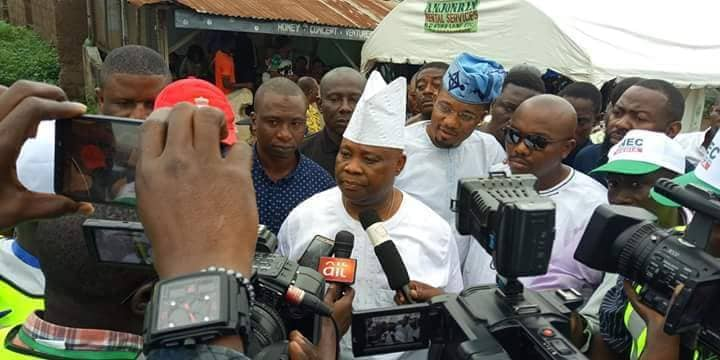Ademola Adeleke addressing journalists