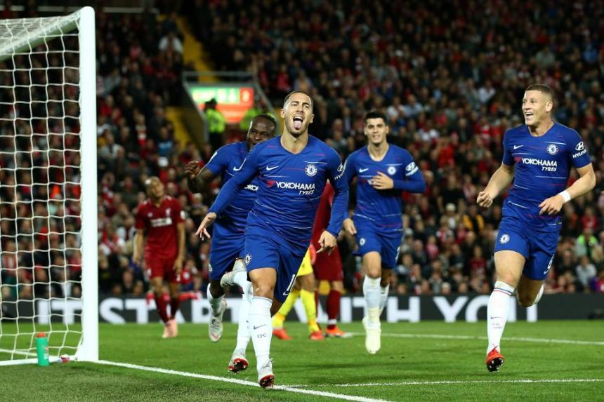 Eden Hazard celebrates after scoring a goal against Liverpool.