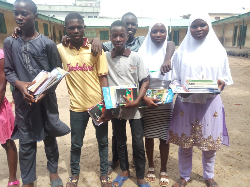 some of the students with their new educational materials