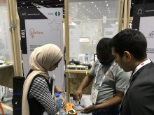 Ahmad Sadiq of WattLinq demonstrating use of his energy managment startup to visitors at his stand