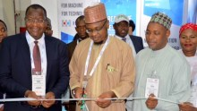 Director general National Information Technology Development Agency (NITDA), Dr Isa Pantami (middle) cutting tape to open the Nigerian pavilion at GITEX 2018 in Dubai, UAE on Sunday, with him is the Executive Vice Chairman/CEO National Communications Commission (NCC) Prof Umar Danbatta (left)