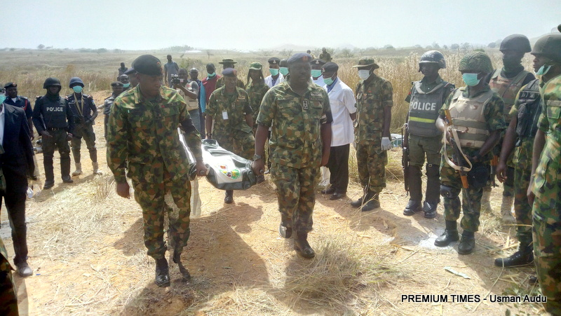 The remains of the missing general being carried by personnel of the Nigerian Army