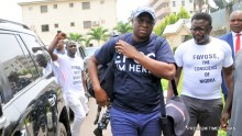 Former Governor of Ekiti State, Mr Ayodele Fayose (M) arrives the Economic and Financial Crimes Commission (EFCC) office in Wuse, Abuja on Tuesday (16/10/18). Fayose arrived the EFCC office, wearing a t-shirt with the inscription, 'EFCC, I am here'. 05029/16/10/2018/Anthony Alabi/NAN