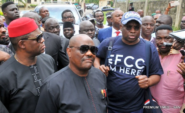 From left: A former Minister of Aviation and a PDP chieftain, Mr Femi Fani-Kayode; Gov. Nyesom Wike of Rivers; former Governor of Ekiti State, Mr Ayodele Fayose; and a lawyer and human rights activist, Mr Mike Ozekhome, at the Economic and Financial Crimes Commission (EFCC) office in Wuse, Abuja where Fayose went to submit himself for interrogation on Tuesday (16/10/18). Fayose arrived the EFCC office, wearing a t-shirt with the inscription, 'EFCC, I am here'.