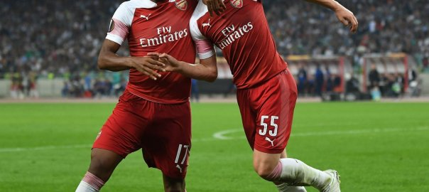 Iwobi celebrates his goal with teammate