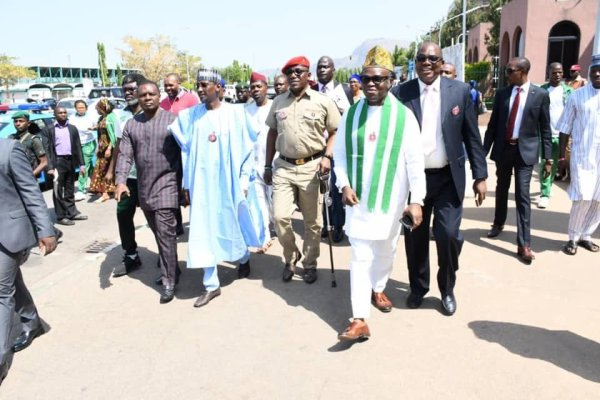 Minister of Sports, and youth development, Solomon Dalung and Minister for F.C.T, Muhammed Bello flanked by other dignitaries at the opening ceremony of the Official clown for the National Sports Festival, Abuja 2018