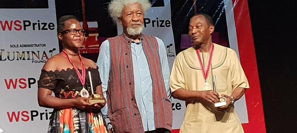 Harriet Anena (L) with renowned African author, Wole Soyinka (C) after winning the prize in Nigeria Credit-softpowernews