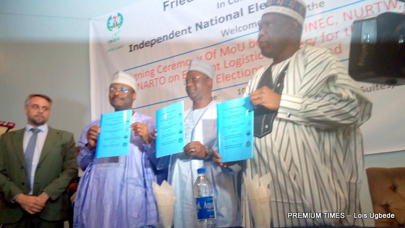INEC Chairman, Mahmood Yakubu signing the memorandum of understanding with NURTW and NARTO