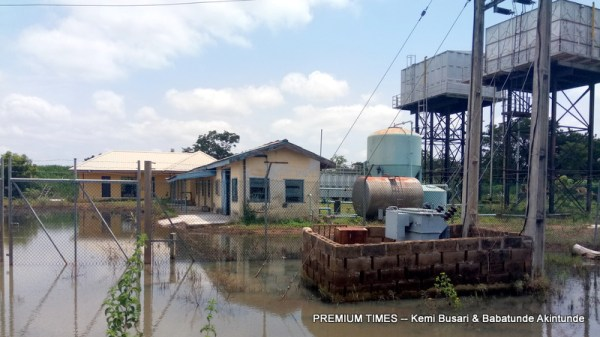 Submerged in water, offices and transformer at the site
