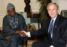 Former Nigerian President Olusegun Obasanjo and Ex-U.S.A President, George Bush. [PHOTO CREDIT: Getty Images]