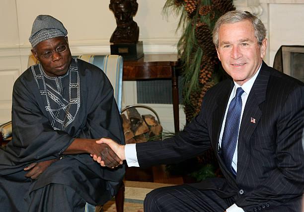 Former Nigerian President Olusegun Obasanjo and Ex-U.S.A President, George Bush. [PHOTO CREDIT: Getty Images]