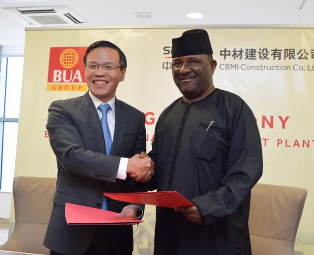 L-R: Mr. Tong Laigou, President CBMI and Abdul lSamad Rabiu, Chairman of both BUA Group and CCNN shake hands after the signing ceremony.