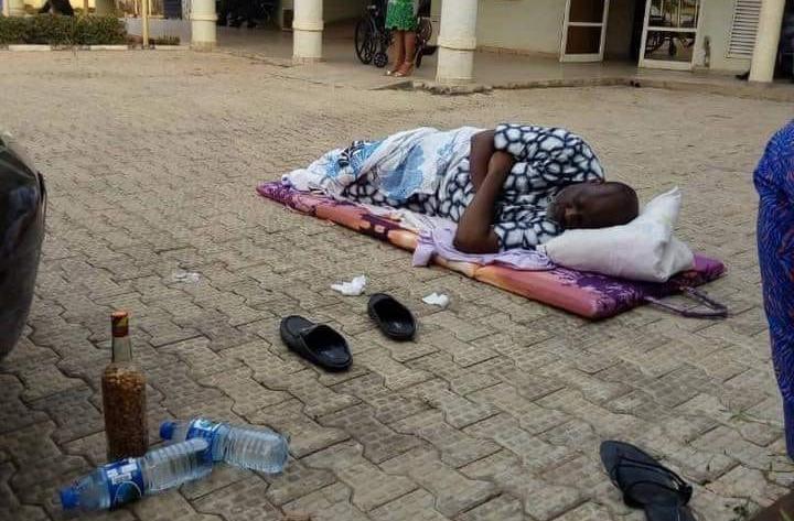 Dino Melaye lying on the floor