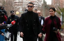 Portugal's soccer player Cristiano Ronaldo arrives with his girlfriend Georgina Rodriguez to appear in court on a trial for tax fraud in Madrid, Spain, January 22, 2019. REUTERS/Susana Vera