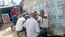 Abuja local barbers at work