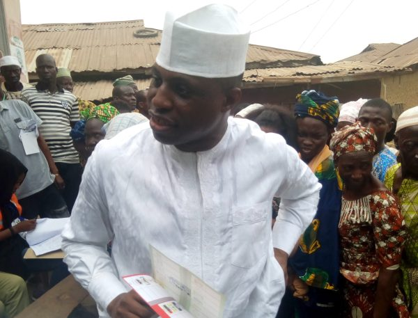 BANKOLE WITH VOTERS PAPER