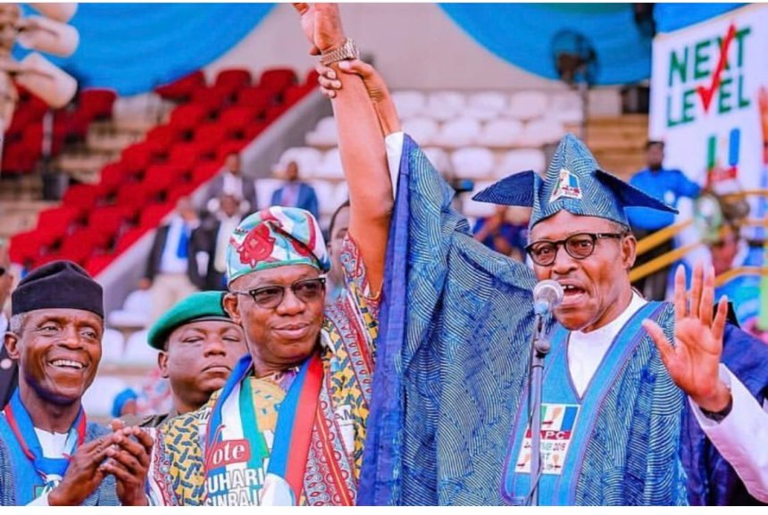President Buhari raises the hand of Dapo Abiodun, the APC candidate in Ogun State gubernatorial elections during his mega rally in the state [Photo: @OfficialAPCNg]