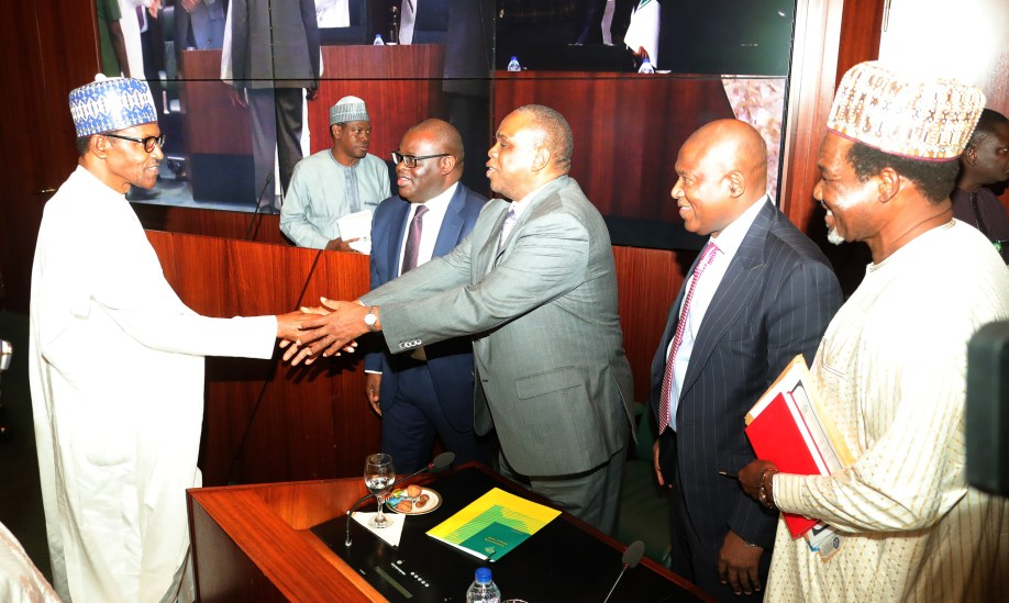 PRESIDENT BUHARI PRESIDES OVER SIGN OF NSEZCOM AND ITS INVESTMENT PARTNERS 6. L-R; President Muhammadu Buhari in a handshake with the President of Afreximbank, Dr Benedict Oramah. Others are, Managing Director Bank of Industry, Mr Olukayode Pitan Representatives of MOFI, Dr Bakari Wadinga, NSEZOM, Mr Femi Edun after the signing of agreements between Afreximbank, BOI and NSIA with Nigeria Special Economic Zones Investment Company (NSEZCOM) and it's Strategic Investment Partners held at the Council Chambers, State House in Abuja. PHOTO; SUNDAY AGHAEZE. FEN 8, 2019