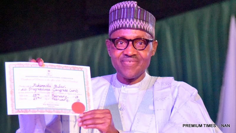 President Muhammadu Buhari displays his Certificate-of-Return as winner of 2019 Presidential election, presented to him by Chairman of INEC, Prof. Mahmood Yakubu, at the International Conference Centre in Abuja on Wednesday (27/2/19). 01779/27/2/2019/Callistus Ewelike/HB/BJO/NAN