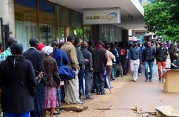 Zimbabweans queue outside banks as new currency begins trading