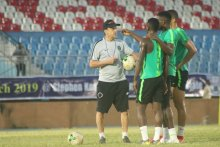 Super Eagles Coach Gernot Rohr discusses tactics with senior palyers before the Seychelles tie Photo Credit PREMIUM TIMES