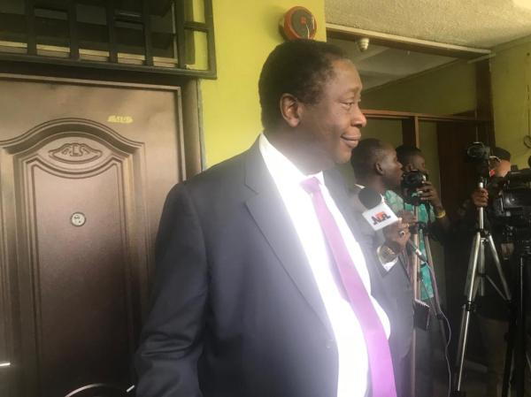 The Chairman, FG re-negotiation team, Dr Wale Babalakin prepring to brief journalists after the meeting
