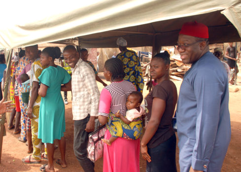 Ekiti State Governor, Dr Kayode Fayemi on queue with other voters for accreditation at Ward 11 Ogilolo polling unit, Isan Ekiti, during the state house of assembly election on Saturday