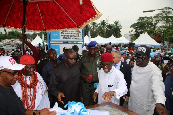 Former Governor of Delta State, Chief James Ibori (3rd left); Delta State Governor, Senator Ifeanyi Okowa (2nd right); Delta State PDP Chairman, Barr. Kingsley Esiso (right); His Royal Majesty Orhur the I, Orodje of Okpe Kingdom (2nd left); Chairman, Sapele Local Government Area, Chief Eugene Okpeh (left) and Others, during the Commissioning of Sapele/Warri Road, from Amukpe Roundabout by Expressway to Okirighwre to AT and P Roundabout Sapele, Delta State. PIX; JIBUNOR SAMUEL.