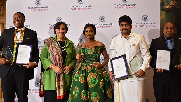 NIGERIA'S OLUWASEUN AYODEJI OSOWOBI (MIDDLE) EMERGES 'COMMONWEALTH YOUNG PERSON OF THE YEAR 2019'. SHE IS FLANKED BY COMMONWEALTH SECRETARY-GENERAL PATRICIA SCOTLAND (2ND LEFT) AND OTHER REGIONAL WINNERS AT A CEREMONY AT THE COMMONWEALTH SECRETARIAT IN LONDON