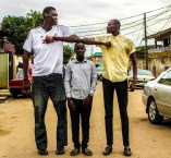 (L) The Tallest Man in Nigeria Afeez Agoro and Bakare Mubarak, the tallest model in Sub Saharan Africa (R)