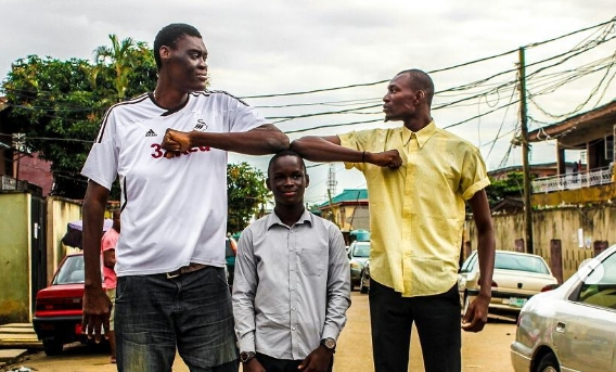 (L)The Tallest Man in Nigeria Afeez Agoro and Bakare Mubarak, the tallest model in Sub Saharan Africa (R)