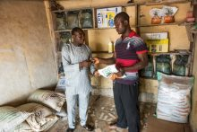 Nigerian entrepreneur Fajemi Gognaje, 35 years old, started a new business in 2016, selling agricultural inputs like seed and fertilizer. The Feed the Future project, implemented by Catholic Relief Services and local partners in Nigeria, was the catalyst by connecting him to private sector suppliers and manufacturers that give him credit. Background: Catholic Relief Services (CRS) in partnership with the Catholic Caritas Foundation of Nigeria (CCFN), Mercy Corps, the Federation for Muslim Women Associations of Nigeria (FOMWAN) and Making Cents International, is implementing the Feed the Future Nigeria Livelihoods Project. This is a 5-year program with support from USAID and cost share from CRS and partners. The Feed the Future Nigeria Livelihoods Project is based in rural communities in Northern Nigeria's Sokoto and Kebbi states, and the Federal Capital Territory (FCT), and is using a multi-sector approach that will help 42,000 very poor households (HHs) grow their agriculture production, incomes and improve nutrition. Photo by Michael Stulman/Catholic Relief Services