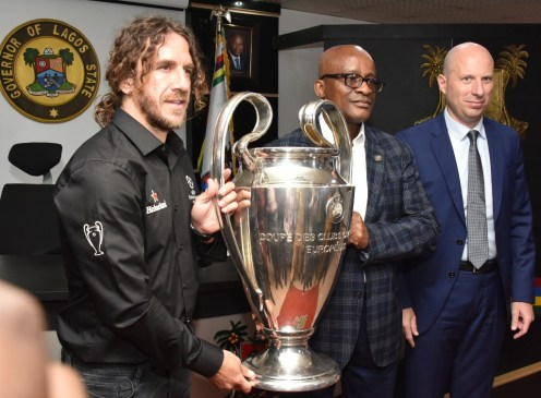 Representative of Lagos State Governor and Chairman, the State Sports Commission (LSSC), Dr. Kweku Tandoh (middle); UEFA Champions League winner and former Barcelona FC Defender, Carles Puyol (left) and Managing Director, Nigerian Breweries PLC, Mr. Jordi Borrut Bel (right) during the UEFA Champions League Trophy Tour to the Lagos House, Alausa, Ikeja, on Wednesday, April 17, 2019.