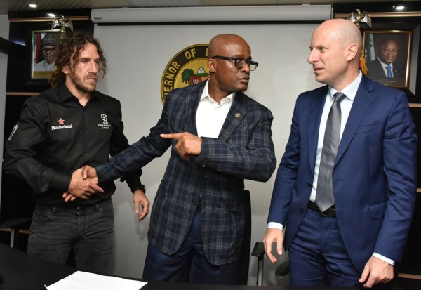 Representative of Lagos State Governor and Chairman, the State Sports Commission (LSSC), Dr. Kweku Tandoh (middle), with UEFA Champions League winner and former Barcelona FC Defender, Carles Puyol (left) and Managing Director, Nigerian Breweries PLC, Mr. Jordi Borrut Bel (right) during the UEFA Champions League Trophy Tour to the Lagos House, Alausa, Ikeja, on Wednesday, April 17, 2019.